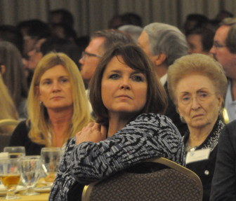 Kim Schaefer, CEO of Great Wolf Resorts, Inc., turns to watch a city promotional video. Schaefer gave a promotional presentation prior to the Mayor's remarks.