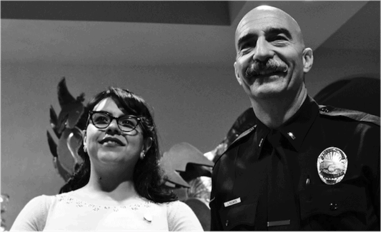Lt. James Kazakos and Elia Renteria of the Anaheim Police Department in the Orange County Family Justice Center. (Photo by: Caitlin Whelan)
