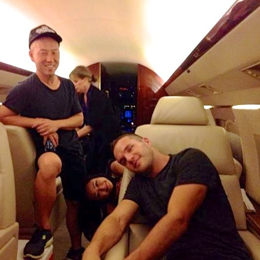 From left: Andy Hong, an unidentified woman, Susan Kang Schroeder and Scott Foster on the private plane in Aug. 2014.