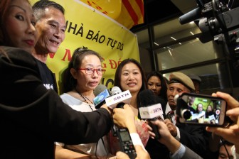 Dieu Cay (2nd left) was among the throng celebrating Ta Phong Tan's (3rd left) arrival at LAX as she was sent straight from prison to the U.S. (Photo: Uyen Vu)