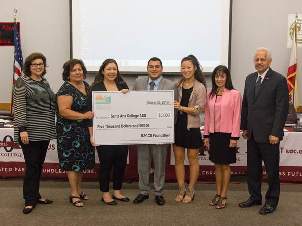 Santa Ana College Associated Student Government (ASG) President Oscar Cortés (center) receives a donation from the Rancho Santiago Community College District Foundation for the SAC ASG from (left to right), Rancho Santiago Community College District Foundation Board Member Arianna Barrios, Santa Ana College President Dr. Erlinda Martinez, Rancho Santiago Community College District Board Student Trustee Raquel Manriquez, Santiago Canyon College ASG Representative Sophia Cho, Rancho Santiago Community College District Foundation Board Member Nelida Yanez, and Rancho Santiago Community College District Chancellor Raúl Rodríguez.