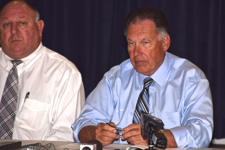 District Attorney Tony Rackauckas (right) at a news conference. Seated next to him is Senior Assistant District Attorney Michael Lubinski.