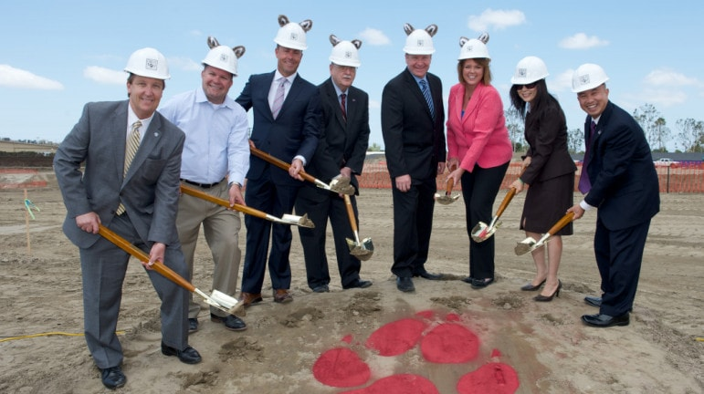 A promotional photo of Great Wolf and McWhinney executives joining Garden Grove city council members at the project's groundbreaking in 2014.