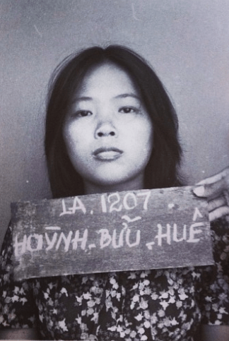 An intake photo of the author's mother, Hue, at a refugee camp in Malaysia.