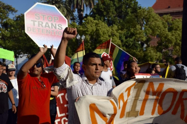 Among the marchers were LGBT advocates protesting the treatment of transgender immigrants.