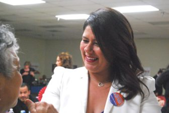 Martinez greets a supporter on Election Night.