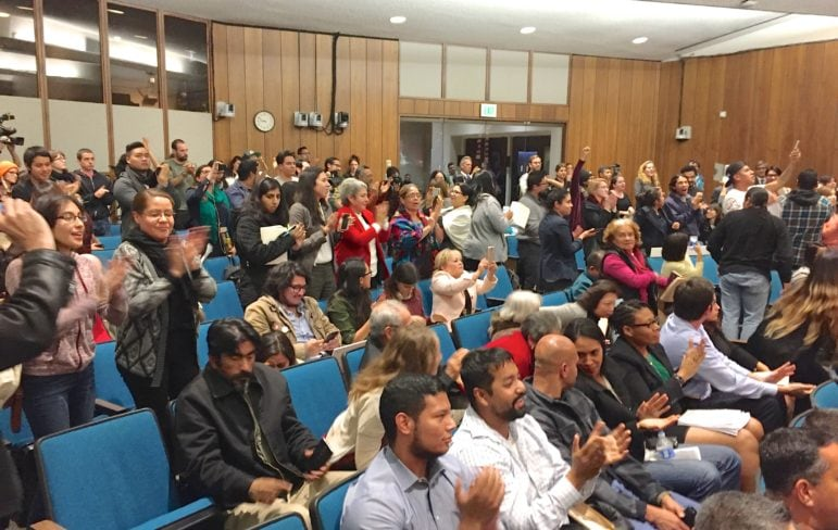 The crowd erupts into cheers after Santa Ana council members declare the city a sanctuary for undocumented immigrants.