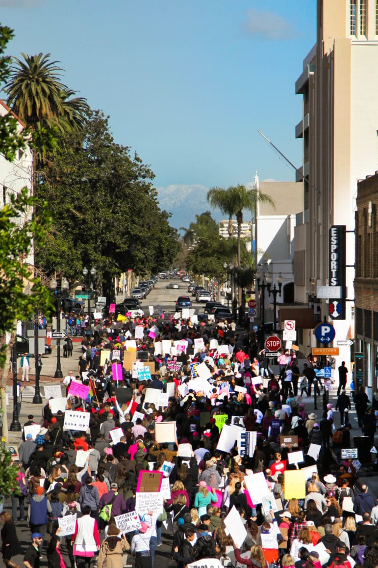 The scene as the marchers are headed down Fourth Street in Santa Ana.